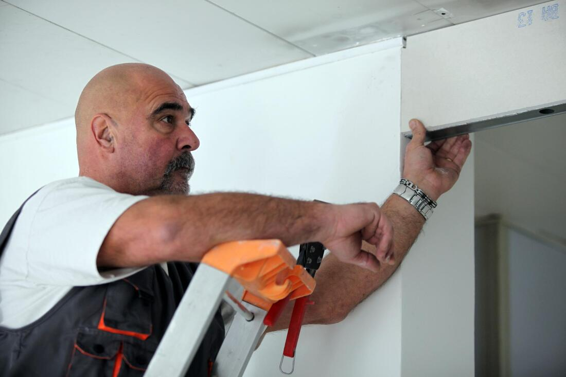 professional drywall expert working on commercial project